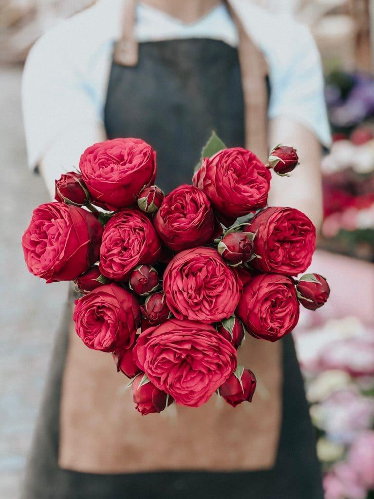 Florist making valentines day flower bouquets